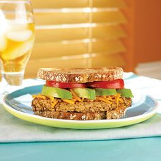 Stacked up high and filled with smooth avocado, juicy tomato, and creamy cheese, this power-protein sandwich is a South Beach vegetarian fav...