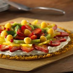 This pizza features a sweet, crisp cereal crust layered with scrumptious cream cheese mixed with marshmallow créme and topped with luscious fresh fruits.