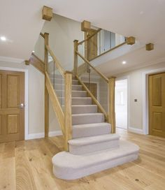 A 4-panel glass stairway and landing balustrade adorns this hallway, part of a brand new residential site in Reading. #GlassStaircase #ToughenedGlass