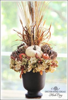 Get wheat, raffia, fall leaves from DIY Autumn Flower Arrangement. Get wheat, raffia, fall leaves from Fall Floral Arrangements, Christmas Flower Arrangements, Wedding Arrangements, Fall Containers, Fall Planters, Autumn Decorating, Decorating Ideas, Arte Floral, Thanksgiving Decorations