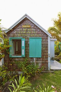 turquoise shutters on a cute little cottage
