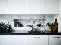 Beautiful marble kitchen - via Coco Lapine Design