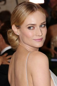 A low, centre-parted chignon is classic and elegant. Diane Kruger complemented her up-do and neutral-toned make-up. Perfect for the big day!