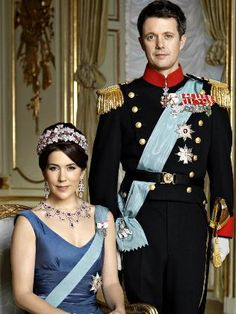 Crown Princess Mary of Denmark and Prince Frederik in a formal photograph. Mary is wearing an impressive suite of diamond and ruby jewelry formerly belonging to Queen Ingrid.