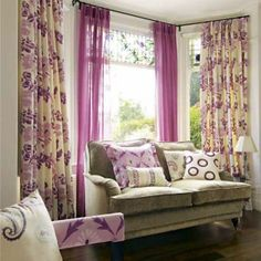 bay window curtain ideas. love the patterned curtains on the outside and a solid color on the inside.