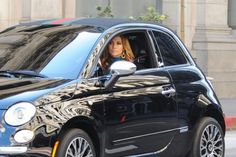 Jennifer Lopez in the Fiat 500 gucci commercial.