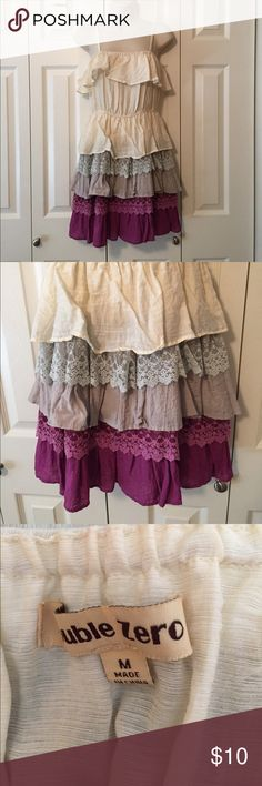 Tiered Festival Sundress This tiered festival sundress by Double Zero in medium is adorable! Cream colored base with purplish hued tiers of different materials are striking. Pair with sandals or brown boots and a suede jacket for a great look! Double Zero Dresses Midi