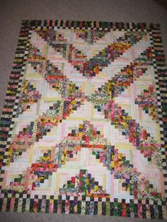 Floral Log Cabin. This is made from the traditional Log Cabin pattern in Judy Martin's Log Cabin Quilt Book.
