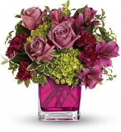 Splendid Surprise by Teleflora in Largo FL, Rose Garden Flowers & Gifts, Inc