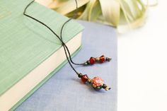 Bookmark with black and red rose bead