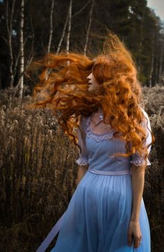 Pre-Raphaelite inspired modern photography. Outdoors, nature, natural long curly red hair and pale blue dress