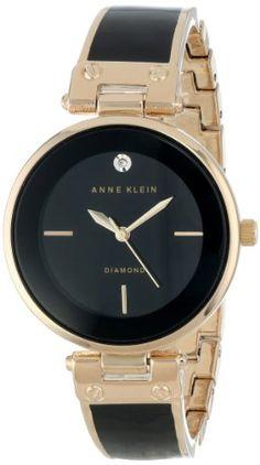 Anne Klein Women's AK/1414BKGB Rose Gold-Tone and Black D... https://www.amazon.ca/dp/B00DND9KGG/ref=cm_sw_r_pi_dp_U_x_w5QGAbBABCHPM