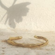 It is made of brass and it can be made of silver or Gold plated brass. Snake, Plating, Earth, Brass, Trending Outfits, Unique Jewelry, Bracelets, Handmade Gifts, Silver