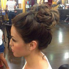 Soft high bun styled by Adrienne