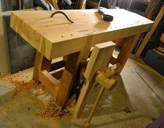 Roubo-style workbench.  Drool.... Now I need a wood-working boyfriend. :)