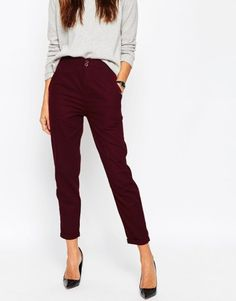ASOS High Waisted Peg Trousers at asos.com. Woven fabric High waistband Side pockets Zip fly with double button fastening Cropped leg Turn-up hem