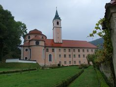 """Weltenburg Abbey is a Benedictine monastery in Weltenburg near Kelheim on the Danube in Bavaria, Germany. The abbey is situated on a peninsula in the Danube, on the so-called """"Weltenburg Narrows"""" or the """"Danube Gorge"""". The monastery, founded by Irish or Scottish monks in about 620, is held to be the oldest monastery in Bavaria. The monastery courtyard is surrounded by Baroque buildings, the highlight of which is the abbey church, dedicated to Saint George, which was built by the Asam…"""