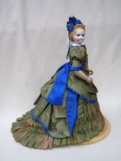 This beauty is dressed to look exactally the way antique dolls were dressed in the 1870's and 1880's.
