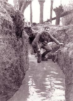 A waterlogged trench on the Western front, a common sight. WW1
