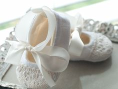 baby shoes with lace, and beads, and ribbon