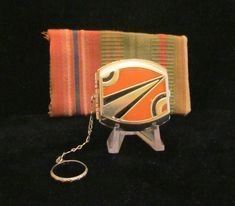 This is a pretty little Art Deco enamel powder and rouge finger ring compact purse in wonderful condition, with only a slight amount of enamel loss, that doesn't detract from the beauty of this unique
