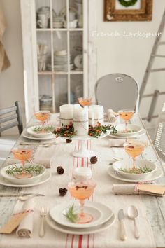 Simple & pretty Holiday table setting.  Website also shows table with a string of lit twinkly lights.  Great idea!