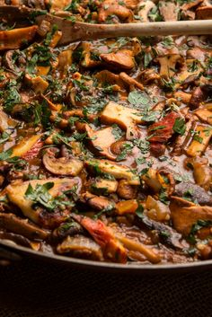 Craving wild mushrooms? I give them a boost of wild flavor in a couple of ways. The first is to make an intense, flavorful broth with a handful of dried porcini. The other is to actually buy some wild mushrooms. A scant half-pound of chanterelles, even if pricey, won't break the bank. The rest of the rustic stew (call it a ragout if you wish) is made of shiitake, cremini and oyster mushrooms.