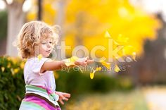 Little girl throwing the fall Leaves royalty-free stock photo