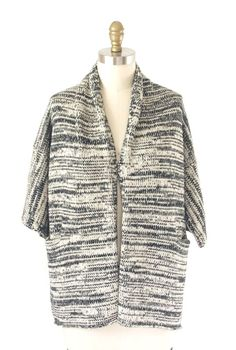 Knitted shawl collar cardigan. Several thin lace-weight yarns can be combined to create the colour effect.