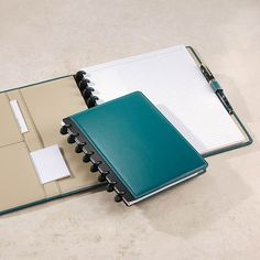 This Circa leather foldover notebook is a big teal Levenger's latest seasonal Circa Leather Foldover Notebook color is teal, with a beautifully contrasting leather interior in dune, plus teal 3/4-inch aluminum discs for good measure. If you like to keep one master notebook for everything, Circa lets you remove notes for filing and then add new sheets.