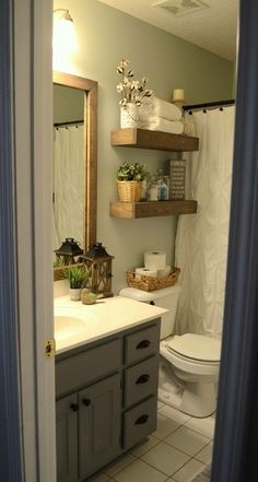 small rental bathroomguest bathroomsbathroom shelvestoilet shelvesbathroom makeoversbathroom ideasmiddle splitsrental makeovertowel display