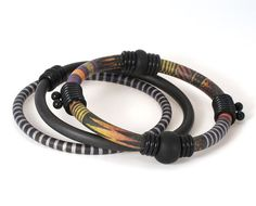Have one of her bracelets, thinking of ordering this one.  They are wonderful!!! Bangle Bracelet Set with African Bark Cloth by designforest, $56.00