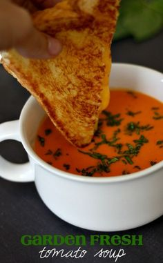 Fresh Tomato Soup Enjoy the fresh taste of tomato soup in the dead of winter with this freezer friendly Garden Fresh Tomato Soup Recipe.Enjoy the fresh taste of tomato soup in the dead of winter with this freezer friendly Garden Fresh Tomato Soup Recipe. Fresh Tomato Soup, Fresh Tomato Recipes, Garden Tomato Recipes, I Love Food, Good Food, Sandwiches, Le Diner, Soup And Sandwich, Canning Recipes