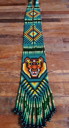 Items similar to Tiger Protection Thick Necklace - 31 bead (Colombia) on Etsy Beaded Crafts, Resin Crafts, Jewelry Crafts, Bead Loom Patterns, Peyote Patterns, Beaded Necklace Patterns, Beads Pictures, Native American Beading, Tear