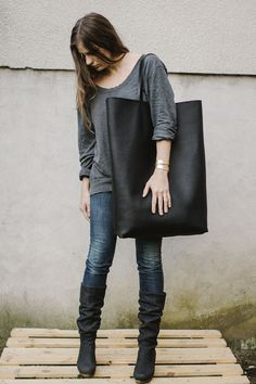 Black Oversized Giant Tote Bag. $220.00, via Etsy. Oversized Tote Bag in black leather.    Big oversized every day tote bag.     Unlined. Natural italian leather .    Aprox. Measurements:     W on top 21 in  W on bottom 16 in  H 23 in  Made to order( 3-5 days)      100%natural leather  100% handmade