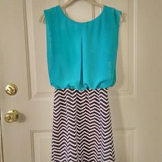 HP!Blue, Black, and White Dress NWT! Dress features a teal blue flowy top and a black and white chevron fitted skirt. Back of dress is open to the middle of the back except for one strap across the top, as pictured. From shoulders to bottom hem dress measures 33.5 inches. Adorable for spring and summer!  HP! Casual Cool Party 4/4/16! Macy's Dresses