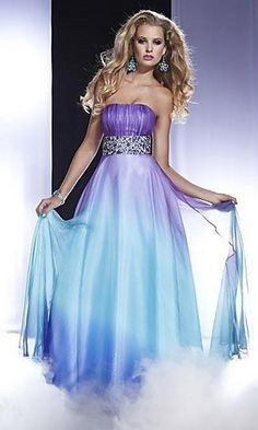 A classic A-line evening dress for prom by Panoply with a colorful twist. This stunning long strapless dress for prom features a ruched bust and sparkling beaded empire waist. The long flowing A-line skirt showcases the subtle ombre shading in tones of purple or pink multi for an elegant and sophisticated look to this long evening gown.