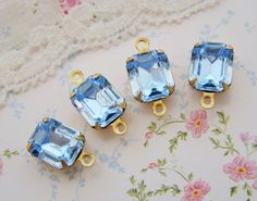 Light Sapphire 10x8mm Swarovski Crystal Octagon Stones in Brass Drop or Connector Settings - 4 10x8mm octagon connector brass setting vintage jewels rhinestones findings set stones faceted swarovski crystal drop Light Sapphire Blue Sapphire 3.85 USD #goriani