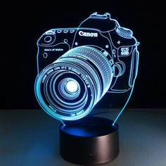 Love Your DSLR? Grab this 3D Illusion Canon Camera Lamp While You Still Can! - Illuminates in 7 colors: (press the button to change the colors) - 1 x USB Cable - Size : Approx. 21.8cm x 15cm - The pie