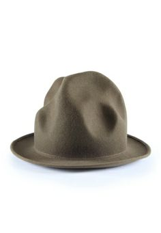 The Mountain or Buffalo Hat, as it is also referred to as, sits 8 inches tall with a 2.5 inch brim. Available in camel, black, navy, green, bordeaux, red and fuchsia pink felt and a woven straw version for the summer.