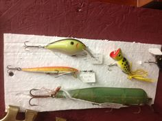 Fishing lures, vintage and fun. Decorate the porch in a beachy theme :)