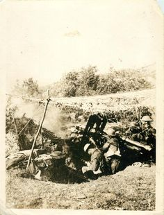 1918- Camouflaged British light artillery battery in action on western front.