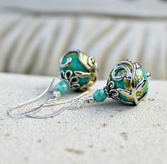 Hey, I found this really awesome Etsy listing at http://www.etsy.com/listing/154802589/turquoise-green-and-gold-lampwork-drop