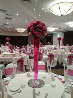 Conical Vase filled with pink water and a flower ball arrangement, by Lily King Weddings