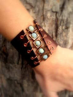 Beautiful baby blue Amazonite stones are framed inside copper squares in this amazing cuff. Genuine metallic copper leather hugs your wrist & comfortably closes with two ball/post closures at the back. MEMBER - SmitherineDesigns