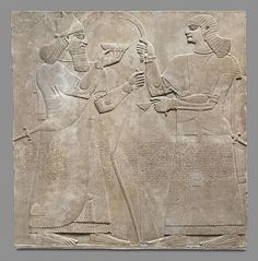 The palace rooms at Nimrud were decorated with large stone slabs carved in low relief, with brightly painted walls and ceilings and sculptural figures guarding the doorways. The throne room contained narrative scenes commemorating the military victories of Ashurnasirpal, while in other areas of the palace were protective figures and images of the king and his retinue performing ritual acts