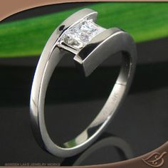 I don't think I would ever get tired of looking at this...maybe in platinum? 14k white gold X-1#engagement ring- bypass style mounting from Green Lake #jewelryworks