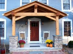 Homeowner and long-time client Tim, lended a hand as we raised the timber frame porch on his family home in Penfield NY.: