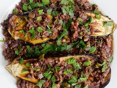 Baked Eggplant with Lamb and Walnut Sauce from Serious Eats. http://punchfork.com/recipe/Baked-Eggplant-with-Lamb-and-Walnut-Sauce-Serious-Eats