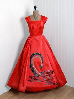 I'm really baffled by what is happening on this skirt...rainbow? Loch Ness Monster?    Emma Domb, 1950's